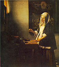 Woman Holding a Balance by Jan Vermeer